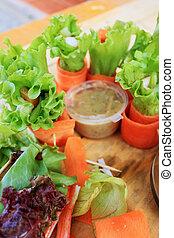 Salad vegetables - carrots, rolls to crab