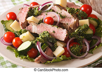 Salad vegetables, cheese and beef steak with chimichurri...