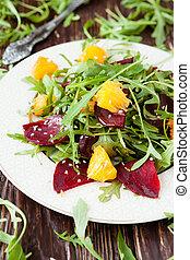 salad with arugula and citrus, healthy food