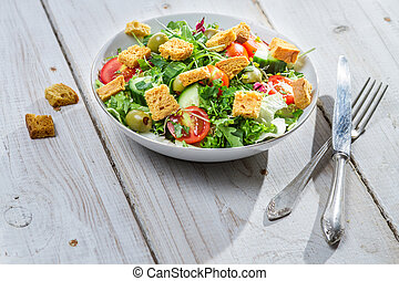 Salad with arugula and tomatoes ready to eat