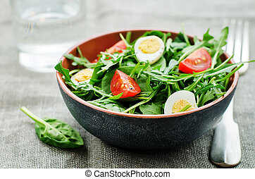 salad with arugula, spinach, tomatoes and eggs. tinting....