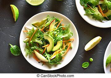 Salad with avocado, green pea, greens, apple