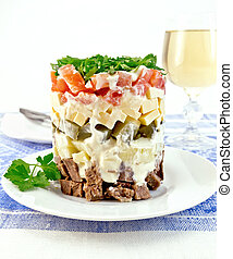 Salad with beef and tomato on tablecloth