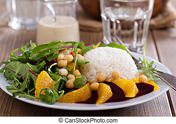 Salad with beet, chickpeas, rice and greens