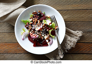 Salad with beetroot and walnuts on a plate