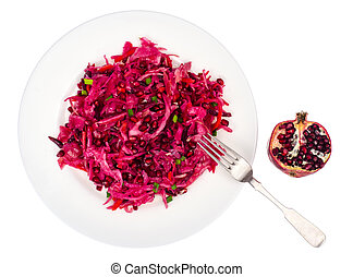 Salad with beets, cabbage, carrots and pomegranate