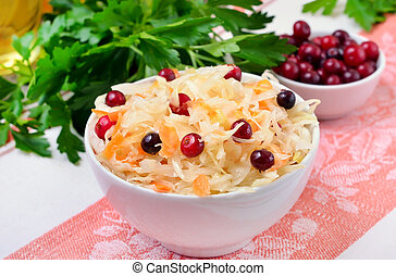 Salad with cabbage and cranberries in white bowl