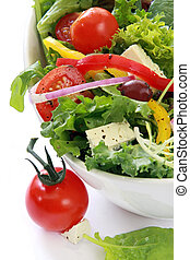 Salad with cherry tomatoes, goat's cheese, peppers, lettuce...