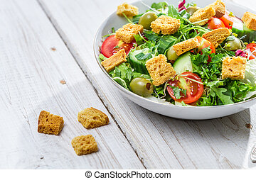 Salad with chicken and fresh vegetables
