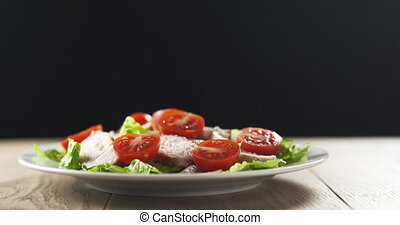 salad with chicken, lettuce and cherry tomatoes, 4k 60fps ...