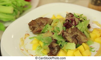Salad with chicken liver and mango
