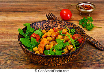 Salad with Chickpeas in a Curry Sauce, Arugula, Grilled Pumpkin and Cherry Tomato