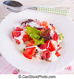 Salad with dressing and fresh raspberry
