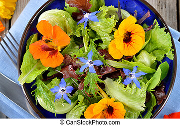 Salad with edible flowers nasturtium, borage. - Fresh summer...