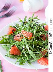 salad with fresh arugula and slices of citrus