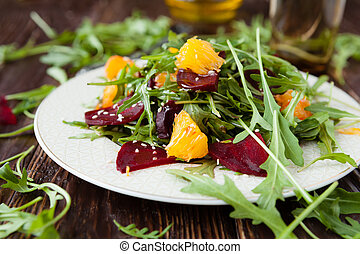 salad with fresh arugula and slices of orange