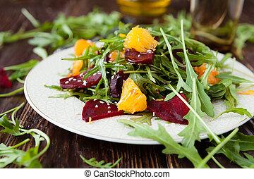 salad with fresh arugula and slices of orange