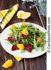 salad with fresh greens, beets and oranges