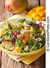 salad with grilled chicken breast, mango, arugula, lettuce,...
