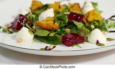 Salad with herring, beetroot, paprika, red onion, mustard...