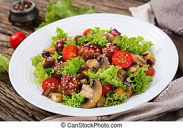 Salad with meatballs, eggplant, mushrooms and tomatoes in Asian style. Healthy food. Diet meal.