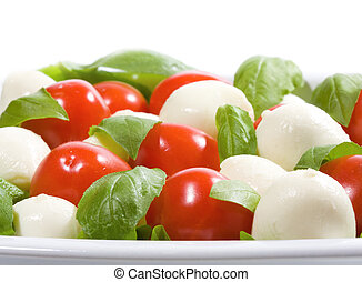 salad with mozzarella and tomatoes on white background