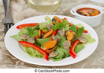 salad with mussels on the white plate
