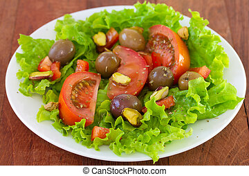 salad with pistachios on plate