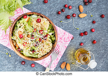 Salad with quinoa, cranberries and almonds.