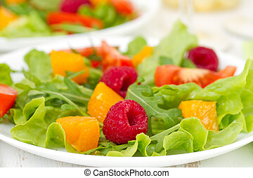 salad with raspberries on plate