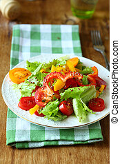 salad with red and yellow peppers and lettuce