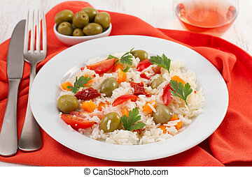 salad with rice and vegetables on the white plate