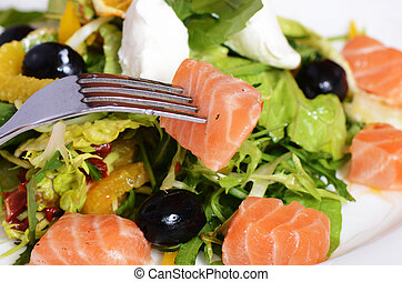 Salad with salmon and mascarpone cheese, pomelo leaves and lettuce. The restaurant dish