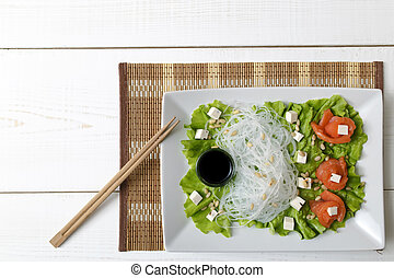salad with salmon, rice noodles and pine nuts
