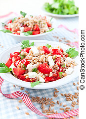 Salad with spelt, rucola, cherry tomato, greek cheese feta