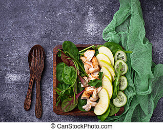 Salad with spinach, chicken, cucumber and apple. Selective...