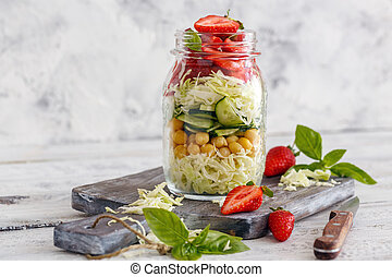 Salad with strawberries and chickpeas in a jar.