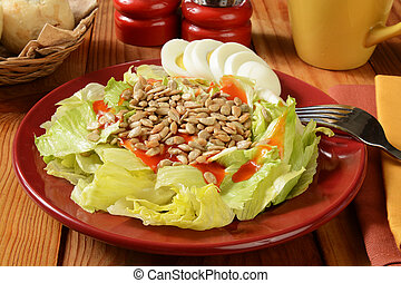 Salad with sunflower seeds and eggs
