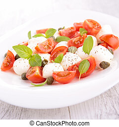 salad with tomato,mozzarella and basil