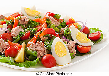 Salad with tuna, tomatoes, potato and onion