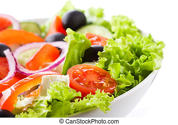 salad with vegetables and greens on white background