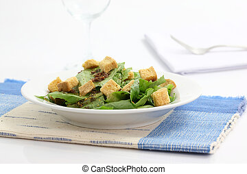Salad with wine glass isolated in white background