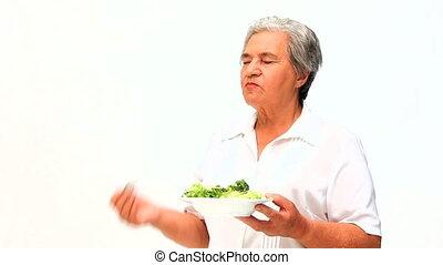salade, femme mange
