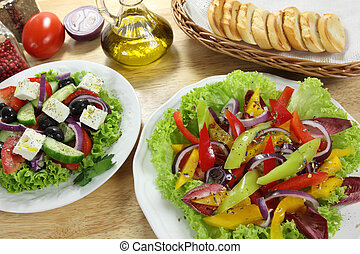 Colorful salads on white plates. Healthy eating.