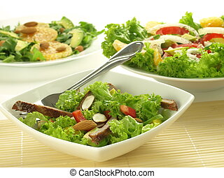 Salads - Three bowls with dietaly light salads with lettuce ...