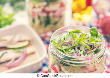 Salads with vegetables and sliced herring fillets - Homemade...