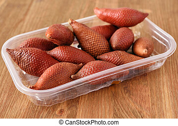 Salak fruits also known as snake fruits in a tray