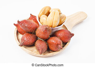 Salak Palm , waive or snake fruit in wooden dish.