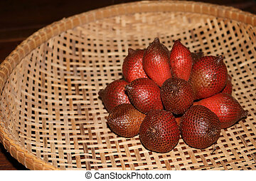 Salak,Fruits in the bamboo basket in Thailand.