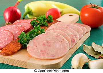 Salami and sausage slices and vegetables